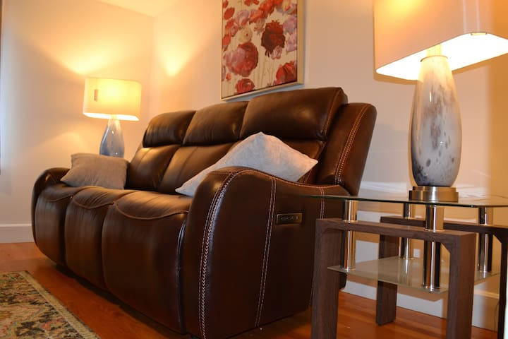 Leather Power Reclining Sofa.
