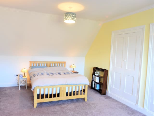 King-size bed in the Matlock master bedroom