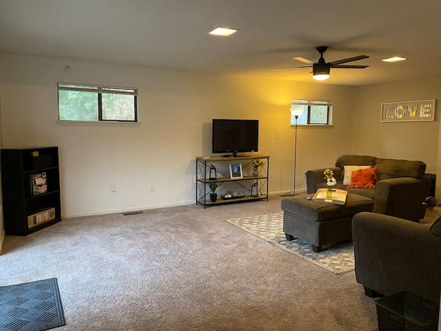 Large living room with additional full size bed.