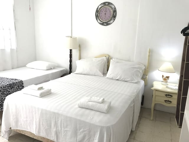 Comfy room with two beds, cable tv, ac.