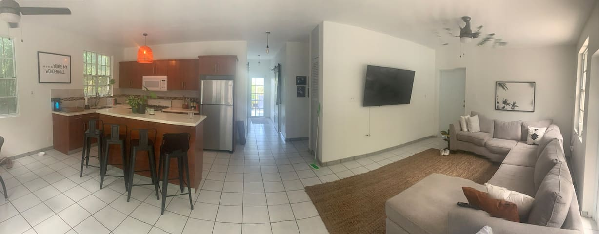 Open kitchen + living area with a 65 inch Smart TV