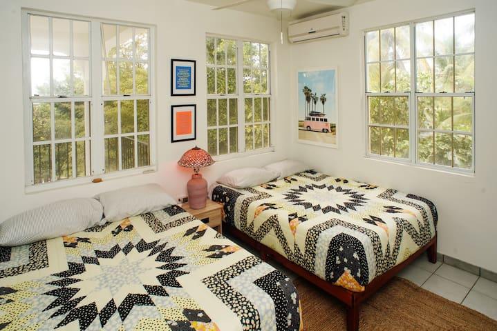 Bedroom with super cozy double queen beds
