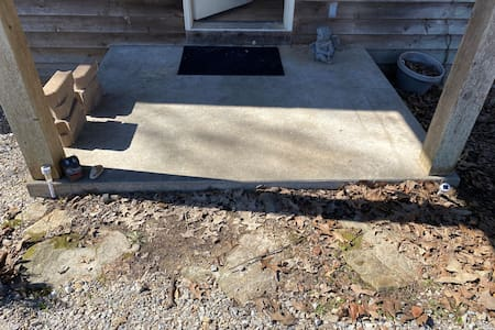 There is a 3inch from gravel to concrete and 6 inch from concrete to inside the house