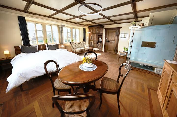 """Double room """"Glärnisch"""" in historic farmhouse"""