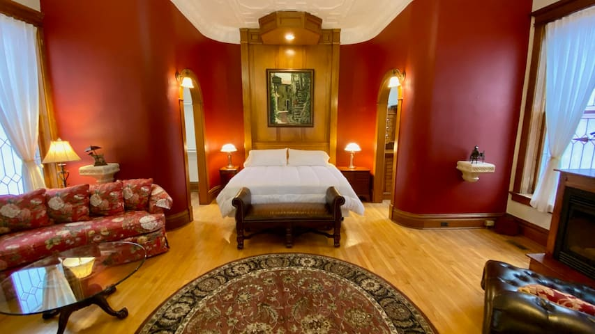 Master Bedroom with a fireplace setting area, a 2nd sitting area with smart TV and 2 walk-in closets
