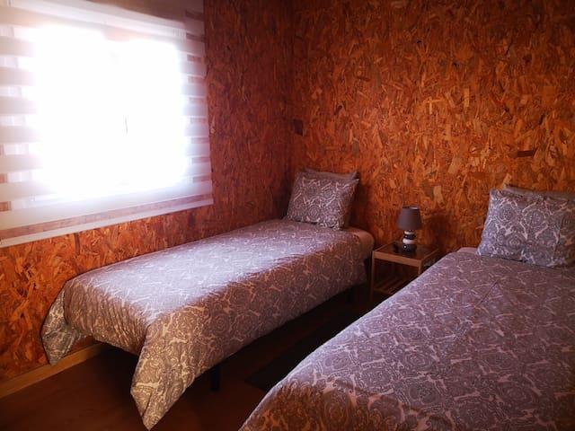 Quarto com duas camas single