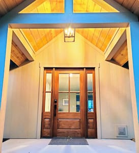 Well lit entry with covered porch and self check in electronic deadbolt keypad.