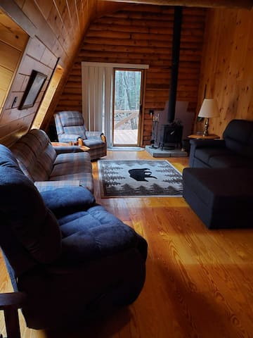 Spacious Living Room with vaulted ceiling, Hide-a-bed, open floor plan to kitchen and large deck.