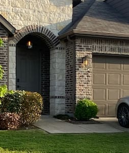 Light above front entry and both sides of garage door.