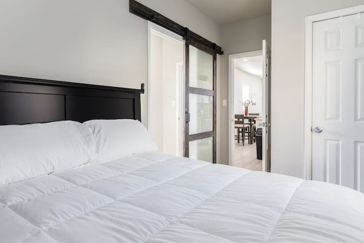 Bedroom with access to the bathroom and laundry room.