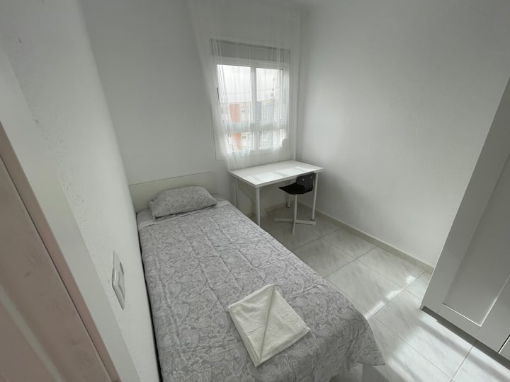 New room with WIFI and views near University. B