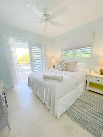 Light and airy bedrooms with luxurious queen-sized beds.
