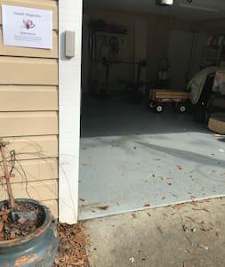 Entrance through the garage with keypad
