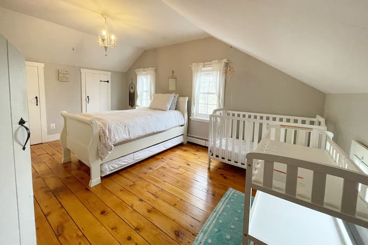 Bedroom #3: with a trundle bed, crib, changing station, and a desk.