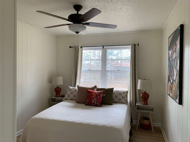 Butterfly Room has queen bed, two nightstands and two reading lamps