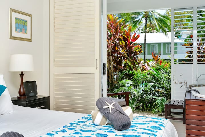 Bedroom with spa on balcony overlooking the Main Pool
