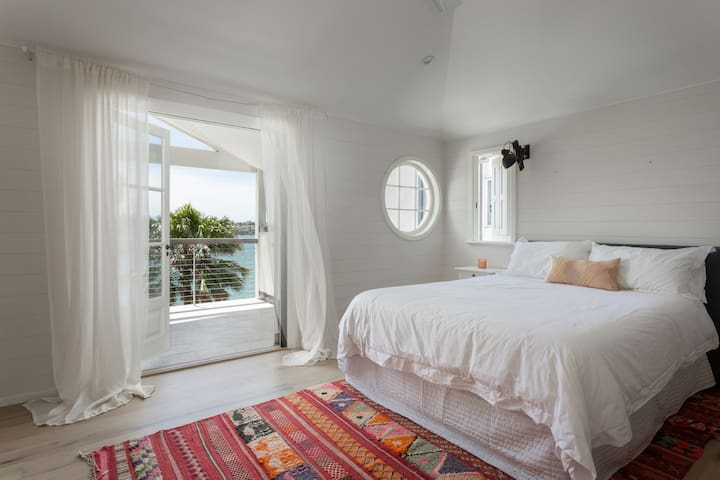 Stay in the naturally-lit bedroom three that features stunning water views and a spacious outdoor balcony