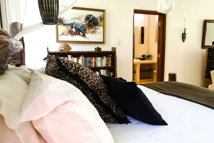 The African Room is situated on the ground floor and opens onto a poolside veranda, with a queen-size bed, air conditioning, floor to ceiling mosquito net, aerodynamic Italian ceiling fan, full bathroom, a beautiful outdoor Bali shower.