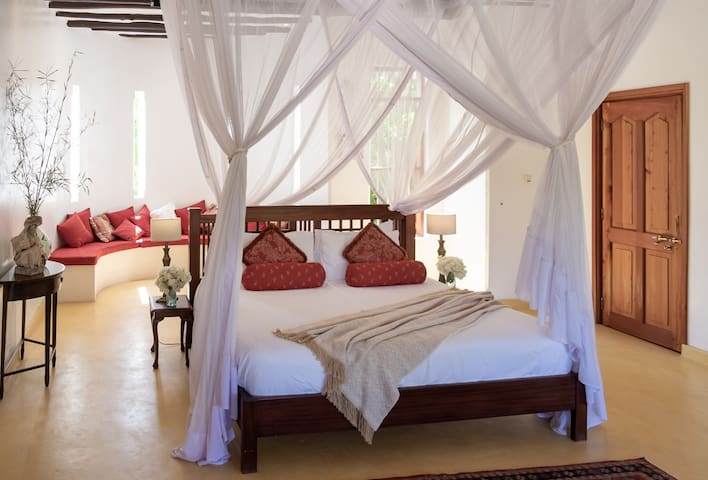 The Superior Room is a haven within itself.   Featuring a Lamu-style balcony overlooking the gardens, a rooftop shower to cool down in the summer heat, or you can relax in the outdoor bubble bath and watch the moon rise.