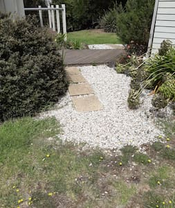 This is the only step to the property which leads to a ramp surrounding the house. It is 3cm high.