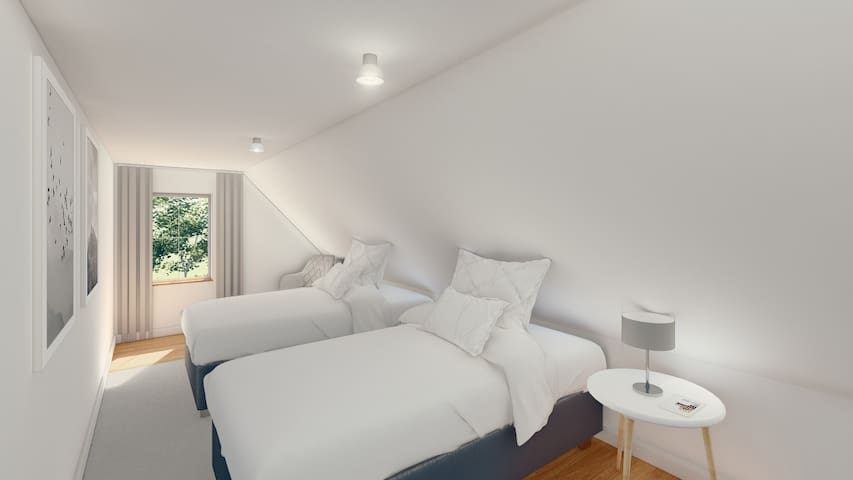 Schlafzimmer 2 - Obergeschoss - Doppel- oder Einzelbett je nach Wunsch
