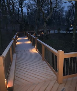 Absolutely level walkway from the upper large parking area directly into home with accent lighting
