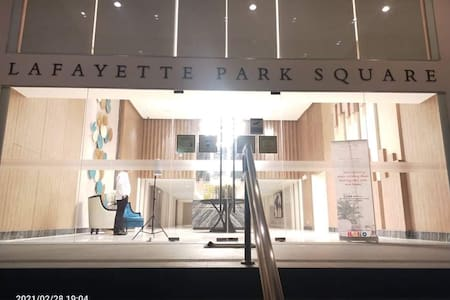 This is the main entrance of Lafayette Park Square, Megaworld Iloilo Business Park, where the condo unit is located. There is a receptionist/security guard 24/7 at the lobby. Guests should wait and sit at the lobby, and Pauline will accommodate them.