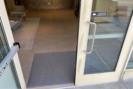 Accessibility: exterior entrance to the building from the sidewalk is pictured.