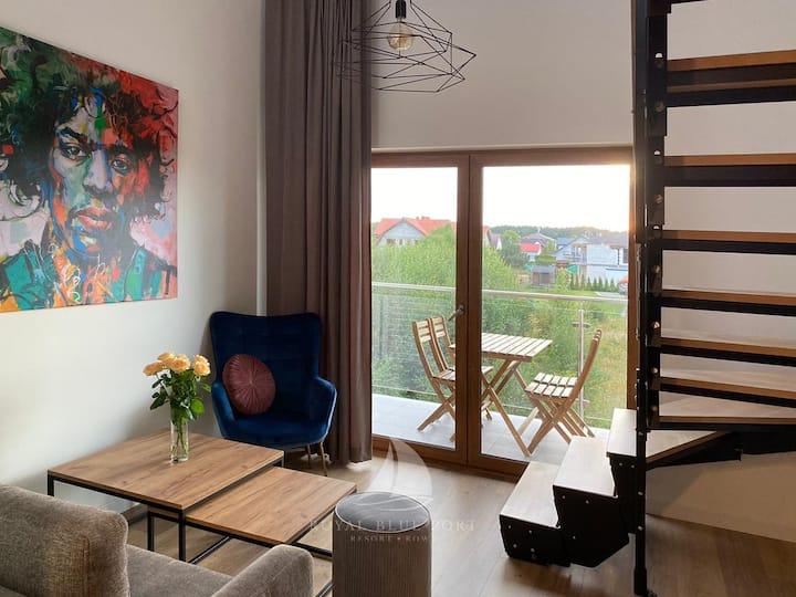 Dwupoziomowy apartament 4 osobowy z balkonem