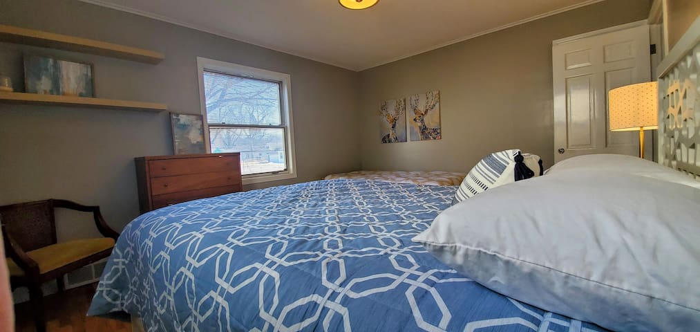 The first of two bedrooms, which has a queen bed and daybed available for use. There is a closet and dresser for your clothing.