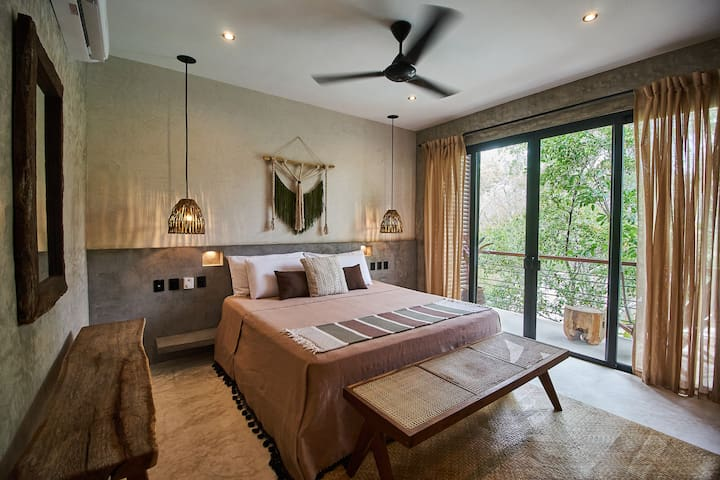 One of the two identical bedrooms, each with their own bathroom and terrace. Both come equipped with king size beds and quality mattresses
