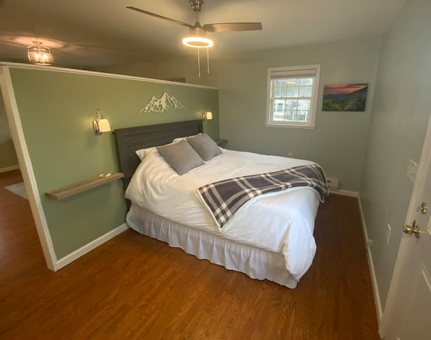 Bedroom is in the back portion of the house with a door leading to your private balcony