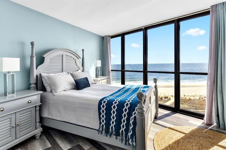 Master bedroom with floor to ceiling oceanfront views