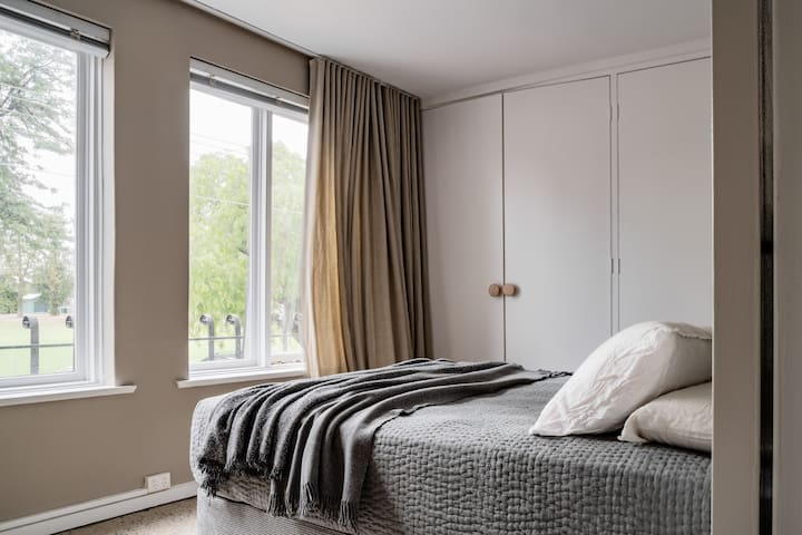 Queen Bed with Well Lit Window