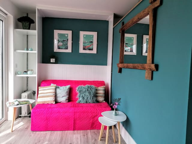 Bright sofa easily pulls out into a comfortable double bed