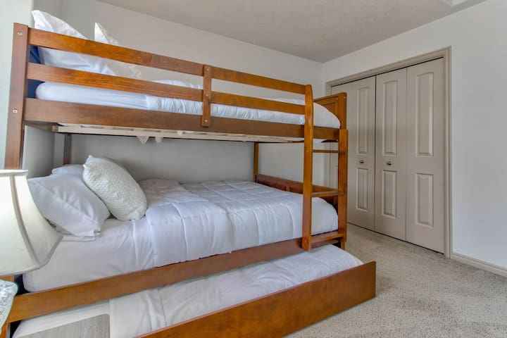 Bedroom #3 has a twin-over-full bunk bed, as well as another trundle twin underneath.
