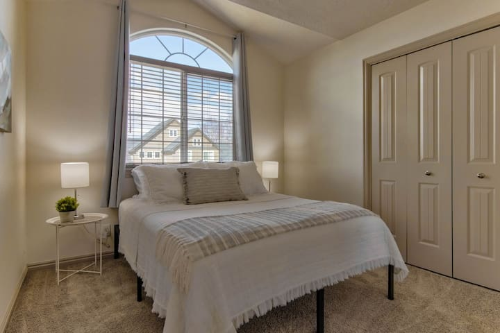 Bedroom #2 features a nice firm Queen size bed. Feel free to use the closet to unpack!