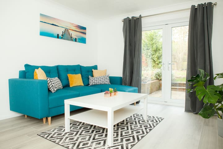 Beautiful newly decorated lounge with access on to the garden.