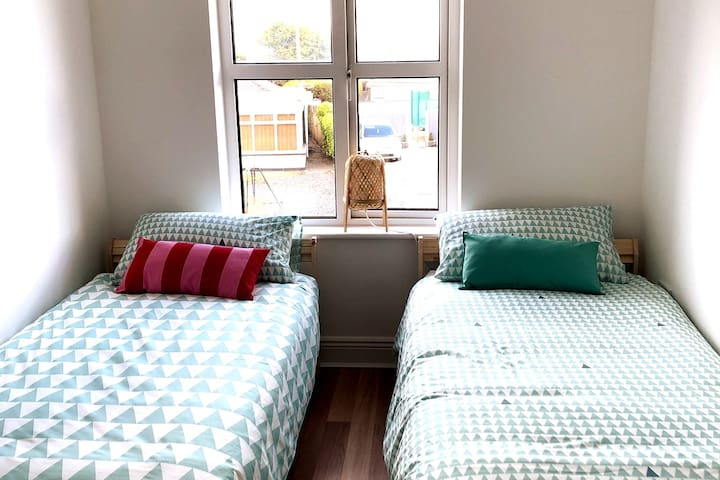 The second bedroom has two single beds and lots of natural light all morning.