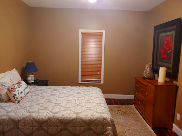 Guest bedroom #2 w/ queen size bed and dresser