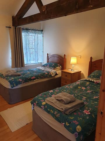 The twin bedroom at Curlew Cottage