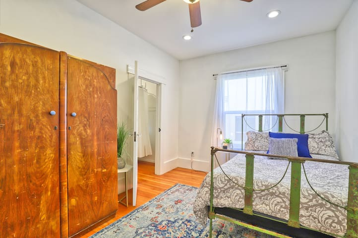 Bedroom One Downstairs w/ Ensuite bath.  Can be used as au/paur or for elderly persons bc of separate entrance via back patio (2 stairs to entry)