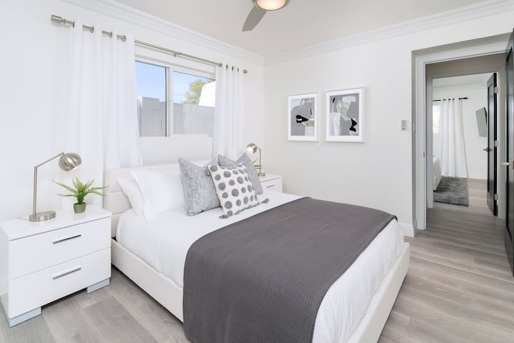 The 3rd bedroom has a queen sized bed and two nightstands with drawers, and a ceiling fan.