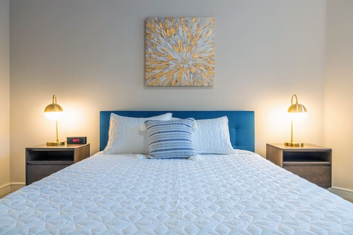 2nd bedroom with a comfortable queen bed. Alarm clock with USB port and bluetooth speaker.