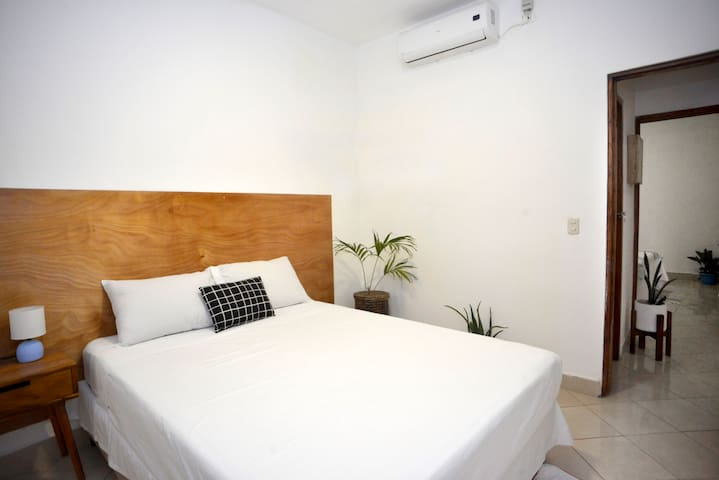 First bedroom with queen bed & aircon