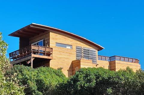 Casa de designers a poucos passos da praia WIFI