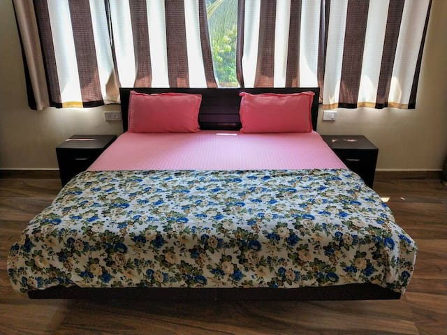 A/c Bedroom - furnished with a double bed & mattress, bedside drawers and a wardrobe