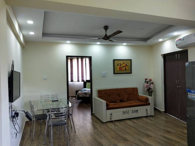 Hall room - furnished with Air conditioner, sofa set with center table, Dining Table with Chairs and LED TV with Satellite Live. There is a double bed sized sofa bed in the hall room