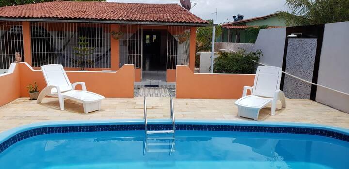 Casa com piscina na Praia de Catuama