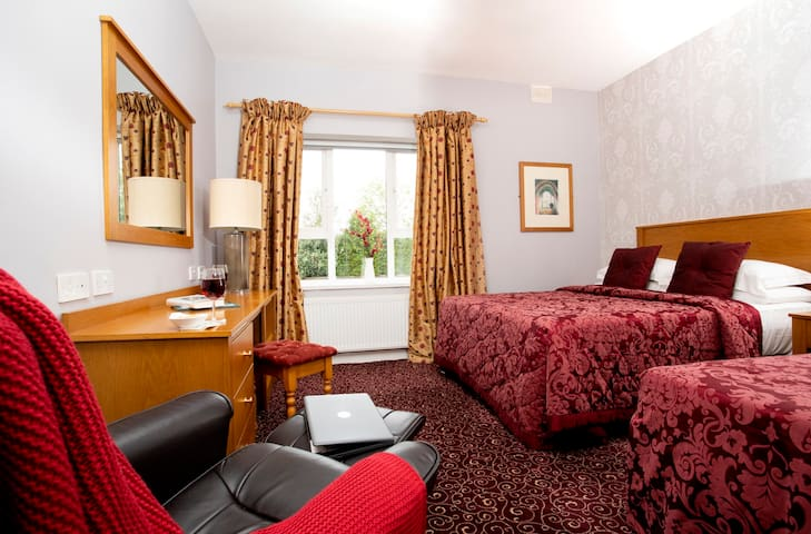 Refurbished in May 2021 to a very high standard. Great size room with an extremely comfortable king size bed 5' and a single bed. Crisp white linen delivered weekly from  a Commercial Hotel laundry supplier.  Walk in shower/bathroom ensuite.
